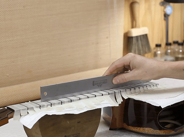 checking_frets_beofre_fret_leveling_and_crowning 600