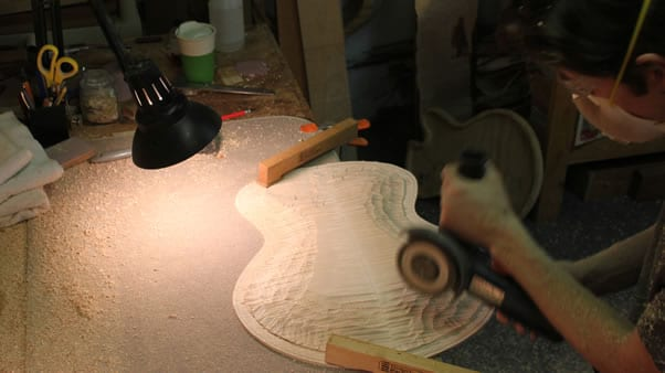 Carving an archtop guitar chainsaw sculpting 2