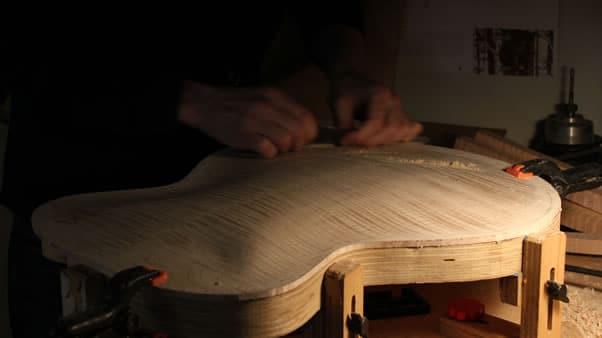 Carving an archtop guitar scraper