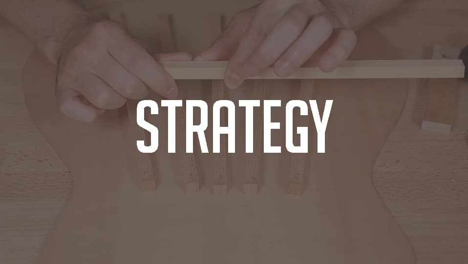 Guitar bracing strategy